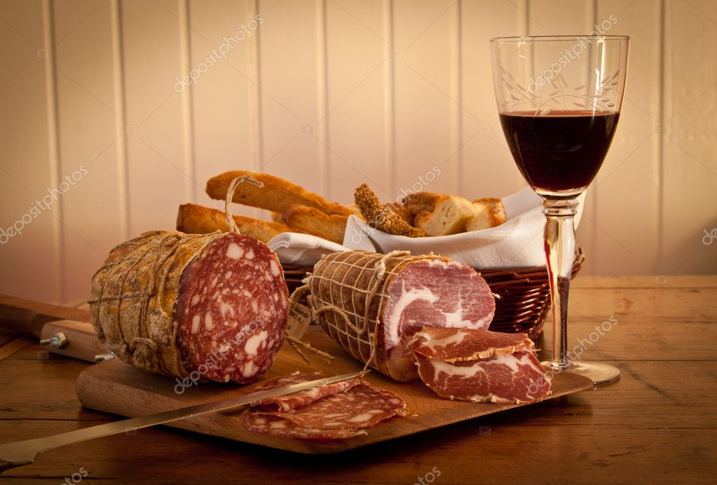 Delicious Italian salami stll life, with fine wine and bread. — Stock Photo #10269360