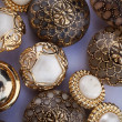 Stock Photo: Group of golden vintage buttons