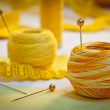 Yellow sewing thread and ribbons, landscape - Stock Photo