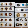 Stock Photo: Boxes of vintage buttons