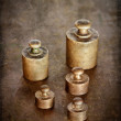 Vintage brass weights — Stock Photo