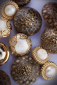 Group of golden vintage buttons — Stock Photo