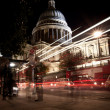 Traffic by St Paul's Cathedral at night - Stock Photo