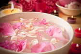 Aromatherapy oils, flower petals, candles — Stock Photo