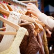 Rack of dresses at market - Stock Photo