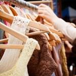Rack of dresses at market — Stock Photo