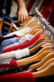 Rack of jumpers at market — Stock Photo