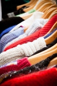 Rack of jumpers at market, close-up — Stock Photo
