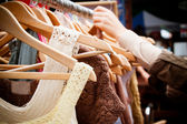 Rack of dresses at market — Stockfoto