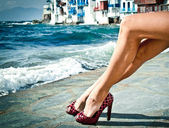 Sexy summer legs by the sea — Stock Photo