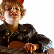 Kid playing guitar — Stock Photo