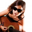 Young girl playing guitar - Stock Photo