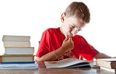 Back to school: a little boy and his homework — Stock Photo