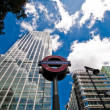 Underground sign and skyscrapers, Canary Wharf — Stock Photo #10464457