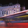 Night bus and taxi at Piccadilly Circus, London - Stock Photo