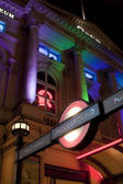 Piccadilly Circus underground station entrance at night — Stock Photo