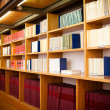 Legal books in a library aisle. - Stock Photo