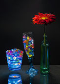 Gerbera and gel balls in the glasses. — Stock Photo