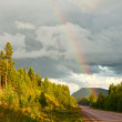 Rainbow over road — Stock Photo