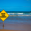 Advice sign on the beach — Stock Photo
