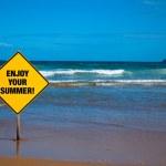 Advice sign on the beach — Stock Photo