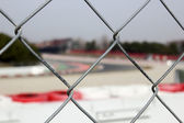 Race track behind the fence — Stock fotografie