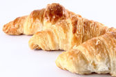 Small croissants in a white background — Stock fotografie