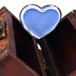 Cosmetics heart in a wood trunk — Stock Photo