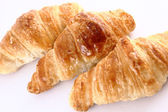 Small croissants in a white background — Stok fotoğraf