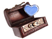 Cosmetics heart in a wood trunk — Stock fotografie
