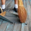 Sweeping with Broom Into Dustpan — Foto de Stock