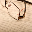 Glasses On Business Report — Stock Photo #10275847