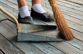 Sweeping With Broom To Dustpan — Stock Photo
