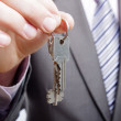 A real estate agent giving keys to a buyer — Stock Photo #10264945