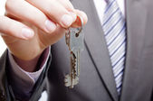 A real estate agent giving keys to a buyer — Stock Photo