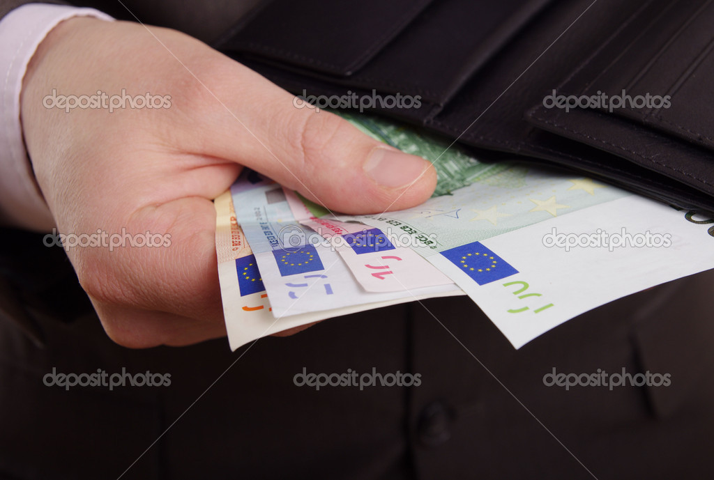 A suited man taking euros out of a black leather wallet — Stock Photo #10264934