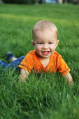 Baby on the grass — Stock Photo