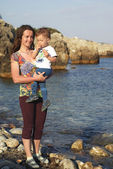 Mother with child at seaside — Stock Photo