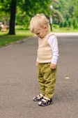 Little boy on stroll in the park — Stock Photo
