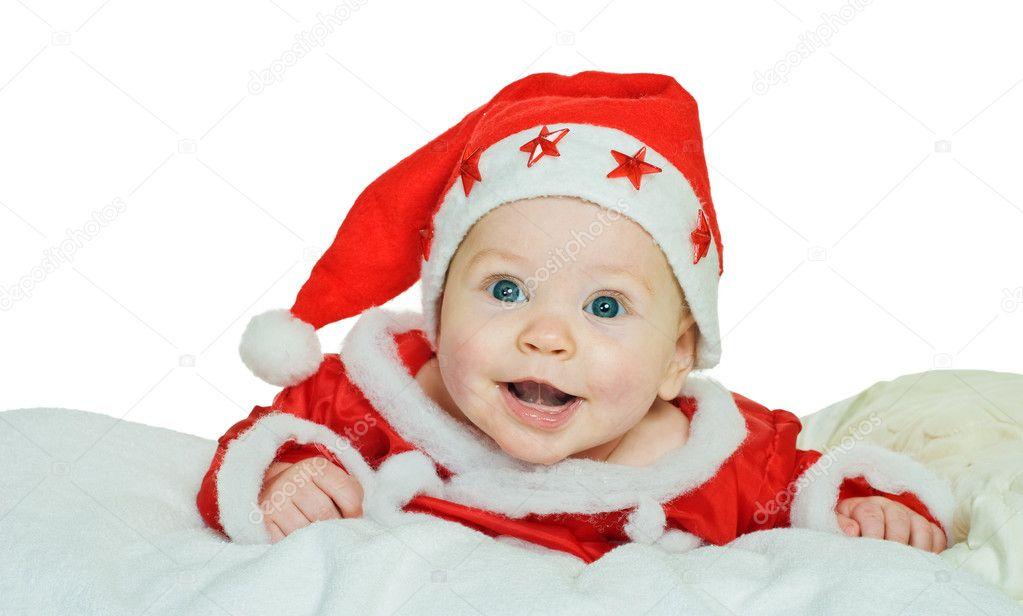 在白色上圣诞老人衣服的小男孩– 图库图片