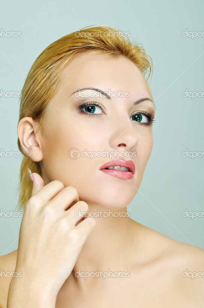 Young beauty woman touches her face — Stock Photo #10642355