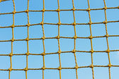 Yellow net against the blue sky — Stock Photo