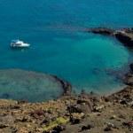 ������, ������: Boat near the volcanic island in ocean