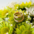 Royalty-Free Stock Photo: Gold rings on the bouquet Suite