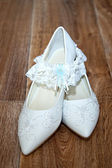 White shoes and bridal garter — Stock Photo