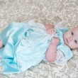 Beautiful little girl in a dress — Stock Photo #10294084