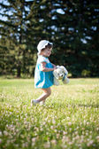 A little girl in a summer park — Stock Photo