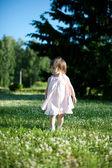 A little girl in a summer park — Stock Photo