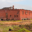 Stock Photo: Abandoned brick building in tundra