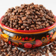 Khokhloma cup filled with pine nuts — Stock Photo